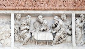 Supper at Emmaus. By Zaccaria da Volterra, door of San Petronio Basilica in Bologna, Italy Royalty Free Stock Photo