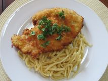 Supper is ready -- Schnitzel and Spaetzle stock images