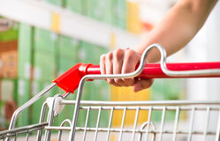 Supping cart and supermarket shelf Royalty Free Stock Images