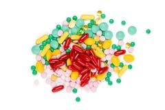 Suppléments de vitamine sur le fond blanc Images libres de droits