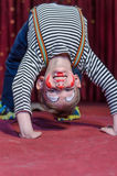 Supple agile little boy doing a back arch Royalty Free Stock Photos