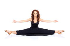 Supple fashionable woman doing the splits Stock Images