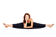 Supple fashionable woman doing the splits Stock Photos