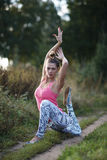 Supple graceful young woman exercising outdoors Stock Photo
