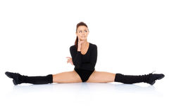Supple woman doing the splits Stock Photography
