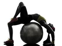 Supple woman exercising fitness  ball workout  silhouette Royalty Free Stock Photos