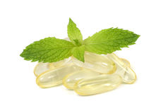 Supplement capsules with fresh mint leaves Royalty Free Stock Photo