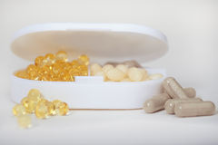 Supplement Container with Pills Royalty Free Stock Photo