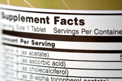 Supplement Facts. Closeup of a bottle of vitamins Stock Images