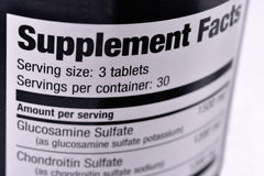 Supplement Facts. Closeup of a bottle of nutritional supplements Stock Image