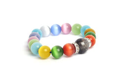 Supplement a good fortune ิั Black Rutilliated Quartz colorful Cat`s eye quartz stone bracelet amulet. With white isolated background Stock Images