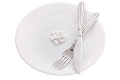 Supplement pills on plate. On white background Stock Photography