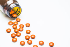 Supplementary food, vitamin, medicine, orange pills. Royalty Free Stock Photography