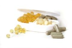 Supplementcontainer met Pillen Royalty-vrije Stock Afbeelding