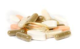 Supplementi in un fondo bianco Fotografia Stock
