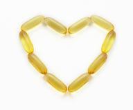 supplements för form för fiskhjärtaolja royaltyfri fotografi