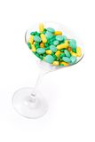 Supplements in the glass, isolated Royalty Free Stock Image