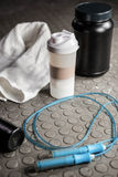 Supplements and rope on the floor Stock Image