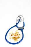 Supplements and stethoscope Stock Images