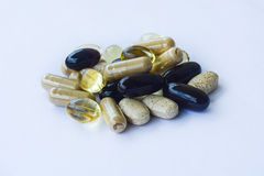 Supplements - Vitamins minerals, omega oils. There are several supplements on this picture, everyday vitamins mineral fatty acids etc royalty free stock photo
