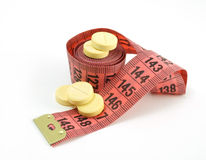 Supplements of weight loss. Measuring tape and pills. supplements of weight loss Royalty Free Stock Image
