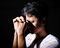 Supplication to God. Man supplication to God in the dark Stock Photo