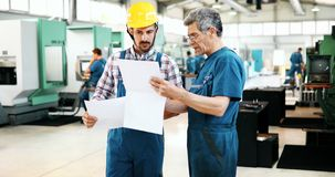 Supplier with engineer checking on production in factory stock images