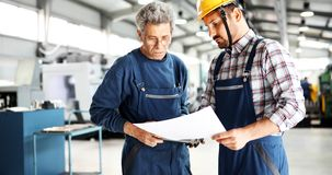 Supplier with engineer checking on production in factory stock photography