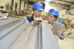 Supplier with engineer checking on production in metallurgic factory Royalty Free Stock Photo