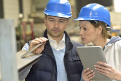 Supplier and engineer checking quality Stock Images