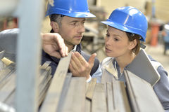 Supplier with engineer checking the quality of products Royalty Free Stock Image