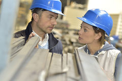 Supplier with engineer discussing production in factory Royalty Free Stock Photo