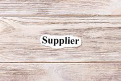 Supplier of the word on paper. concept. Words of Supplier on a wooden background royalty free stock images