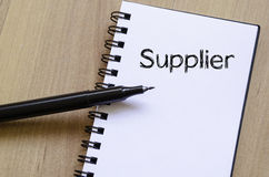 Supplier write on notebook. Supplier text concept write on notebook with pen Royalty Free Stock Images