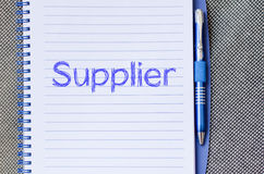 Supplier write on notebook. Supplier text concept write on notebook with pen Royalty Free Stock Image