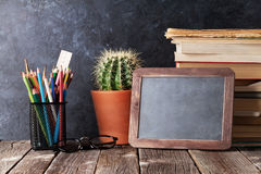 Supplies, cactus and chalk board Stock Photo