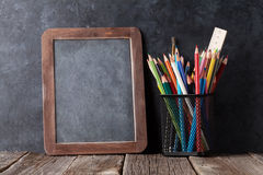 Supplies  and chalk board Stock Photography