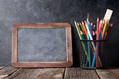 Supplies  and chalk board Stock Photo