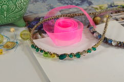 Supplies for jewelry, ribbon, beads Stock Image