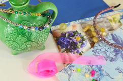 Supplies for jewelry, ribbon, beads Stock Photos