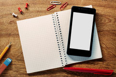 Supplies and Mobile Phone on Top of the Table. Close up High Angle View of School Supplies and Mobile Phone on Top of the Textured Table with Copy Space for Royalty Free Stock Image