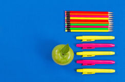 Supplies for office or back to school on blue background Stock Photography