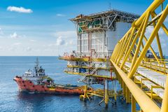 Supply boat come to oil and gas accommodation platform to send food and drink, material Stock Photo