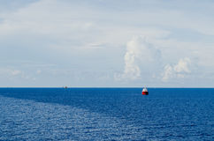 Supply boat on oil field. With blue sea Royalty Free Stock Photo
