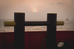 Supply boat. In oilfield when sunset Stock Images