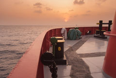 Supply boat. In oilfield when sunset Stock Photo