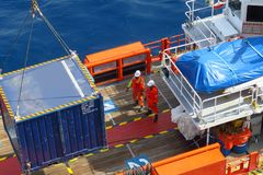 Supply boat transfer cargo to oil and gas industry and moving cargo from the boat to the platform. Boat waiting transfer cargo and passenger between oil and stock photography