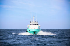 Supply boat transfer cargo to oil and gas industry and moving cargo from the boat to the platform, boat waiting transfer cargo Royalty Free Stock Images