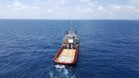 Supply boat transfer cargo to oil and gas industry and moving cargo. Supply boat transfer cargo to oil and gas industry and moving cargo from the boat to the royalty free stock images