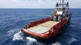 Supply boat transfer cargo to oil and gas industry and moving cargo. Supply boat transfer cargo to oil and gas industry and moving cargo from the boat to the stock image